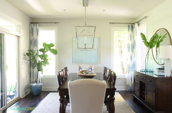 Formal shot of our elegant dining room with Behr Silver Drop walls and blue and white accents.