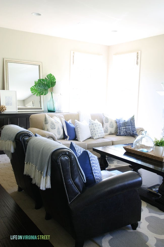 Neutral Living room with blue, green and white accents.