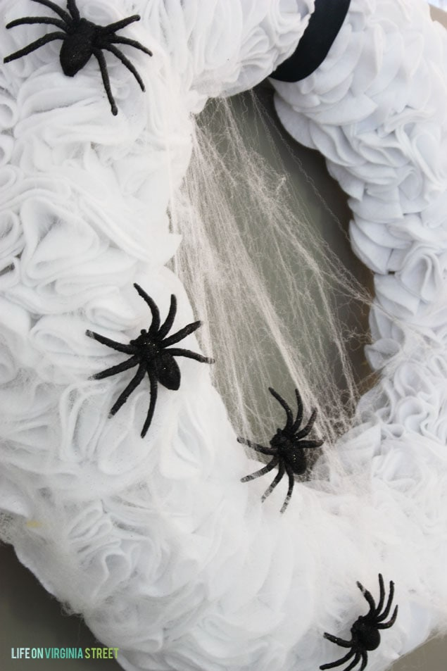 Cobwebs and black spiders on the ruffled wreath.
