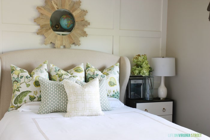 I love the green pillows--they're so fresh and inviting. They go perfectly with the sprig of hydrangeas on the nightstand.