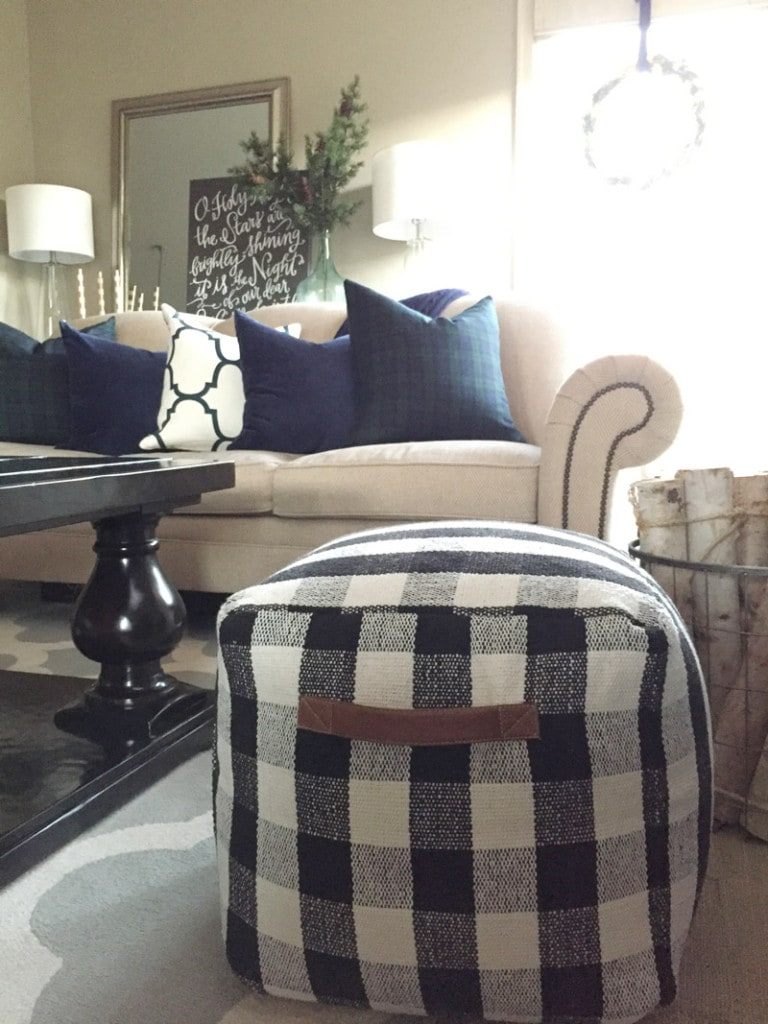 Winter livingroom accents--featuring navy blue pillows and a new buffalo checked pouf.