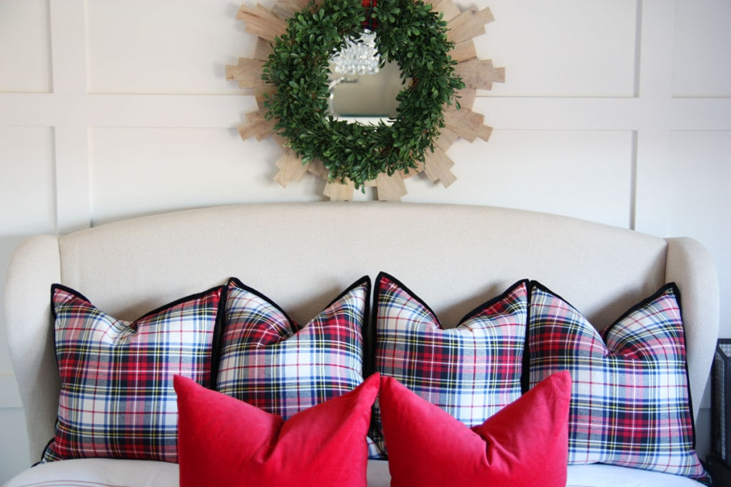 Plaid pillows on the bed.