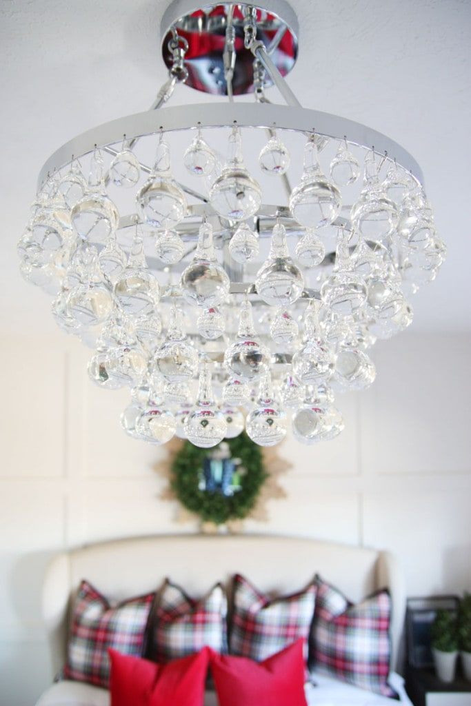 Guest bedroom glass chandelier in bedroom.