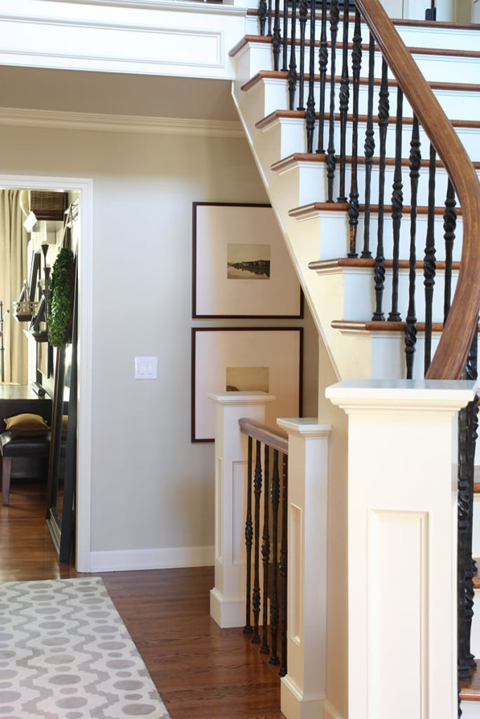 Entryway staircase with iron banisters and a beautiful neutral wall colors - Neutral Home Tour - Life On Virginia Street