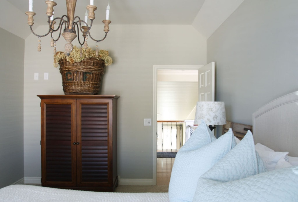 Guest Bedroom Bedding, wardrobe, and door into the hallway. - Neutral Home Tour - Life On Virginia Street