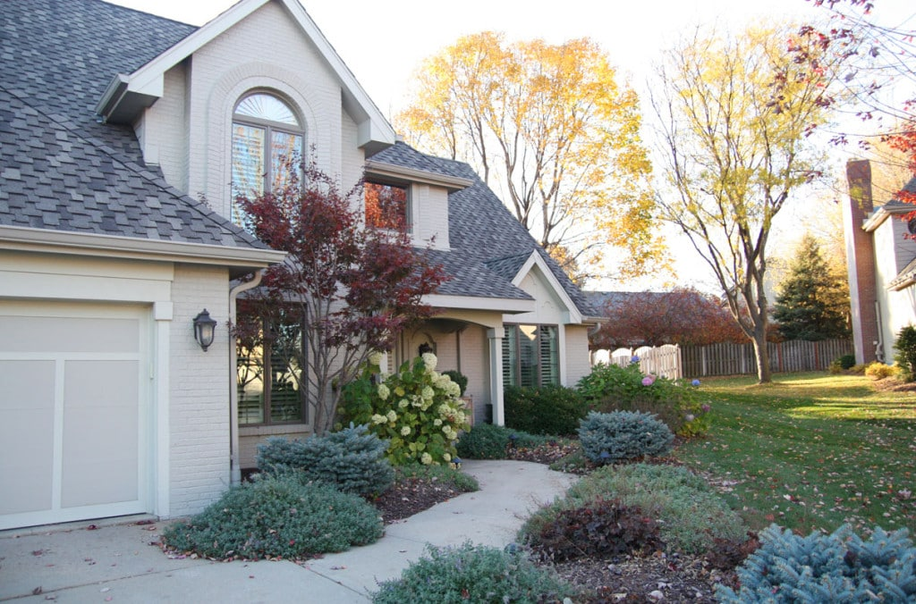 Omaha Home Exterior. You'd never know this home was built in the 80's. This gorgeous neutral exterior looks modern and brand new and looks stunning alongside these gorgeous fall colors. - Neutral Home Tour - Life On Virginia Street