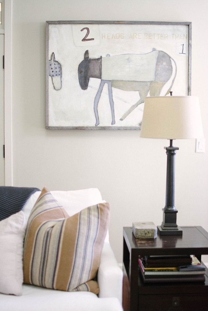 Living Room Art that matches the neutral color scheme of the room. Love this lamp and end table combo. - Neutral Home Tour - Life On Virginia Street