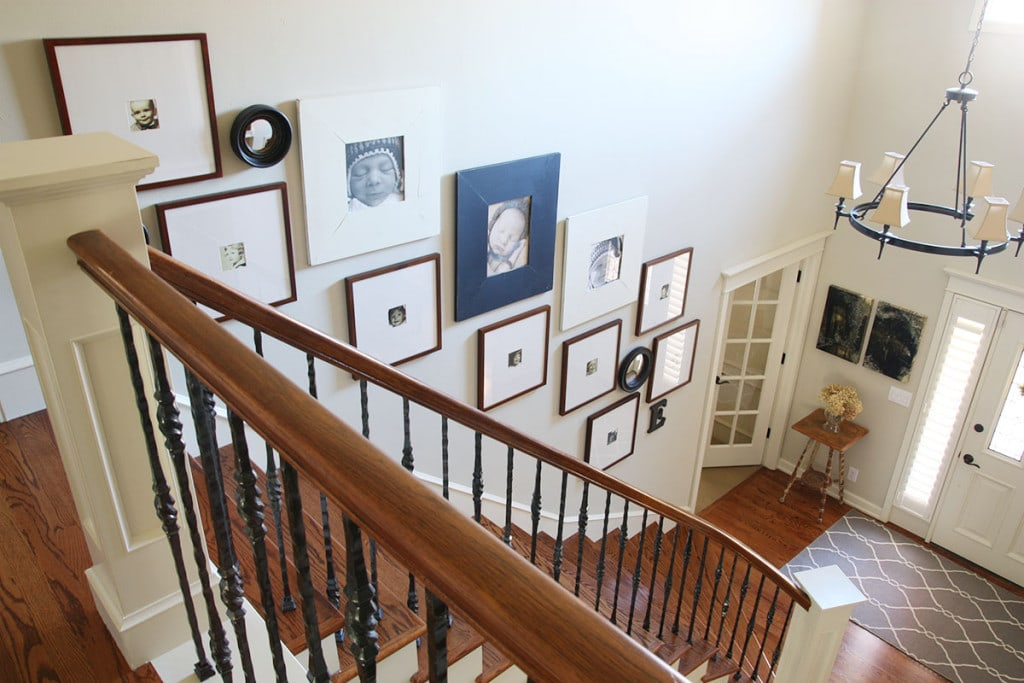 Staircase gallery frames, front entry way and gallery wall leading upstairs. - Neutral Home Tour - Life On Virginia Street