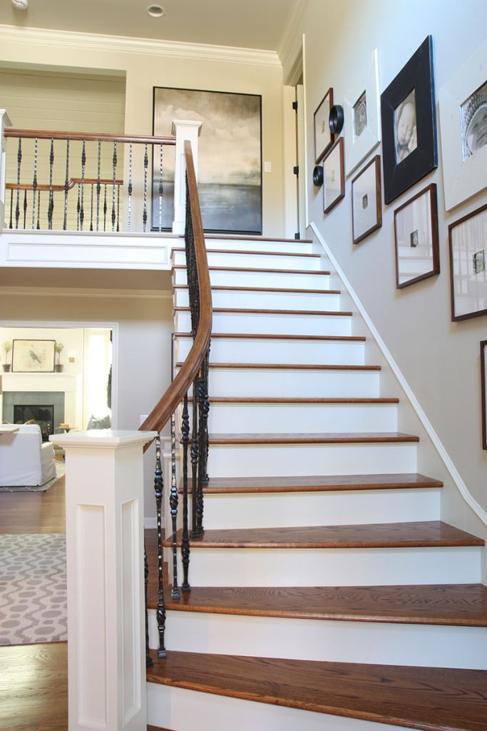 Staircase with a sleek, simplistic gallery wall. - Neutral Home Tour - Life On Virginia Street