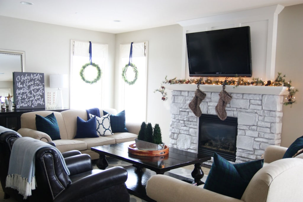 A Christmas living room with navy blue and hunter green decor.