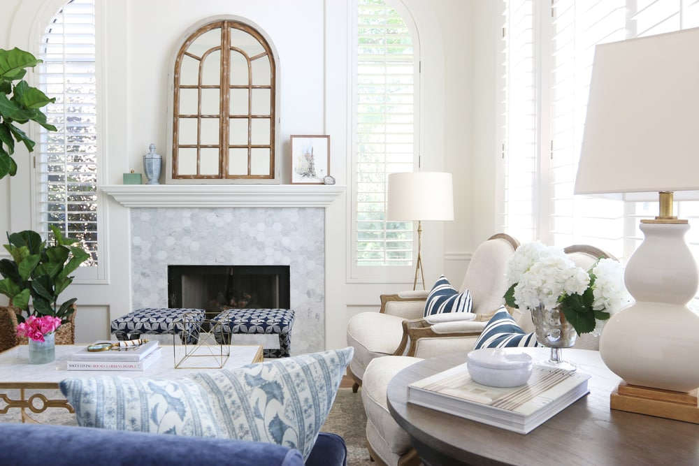 Navy White and Gray Living Room with pink flowers on table.