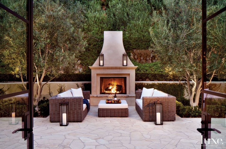 Outdoor Fireplace and Living Area via Luxe