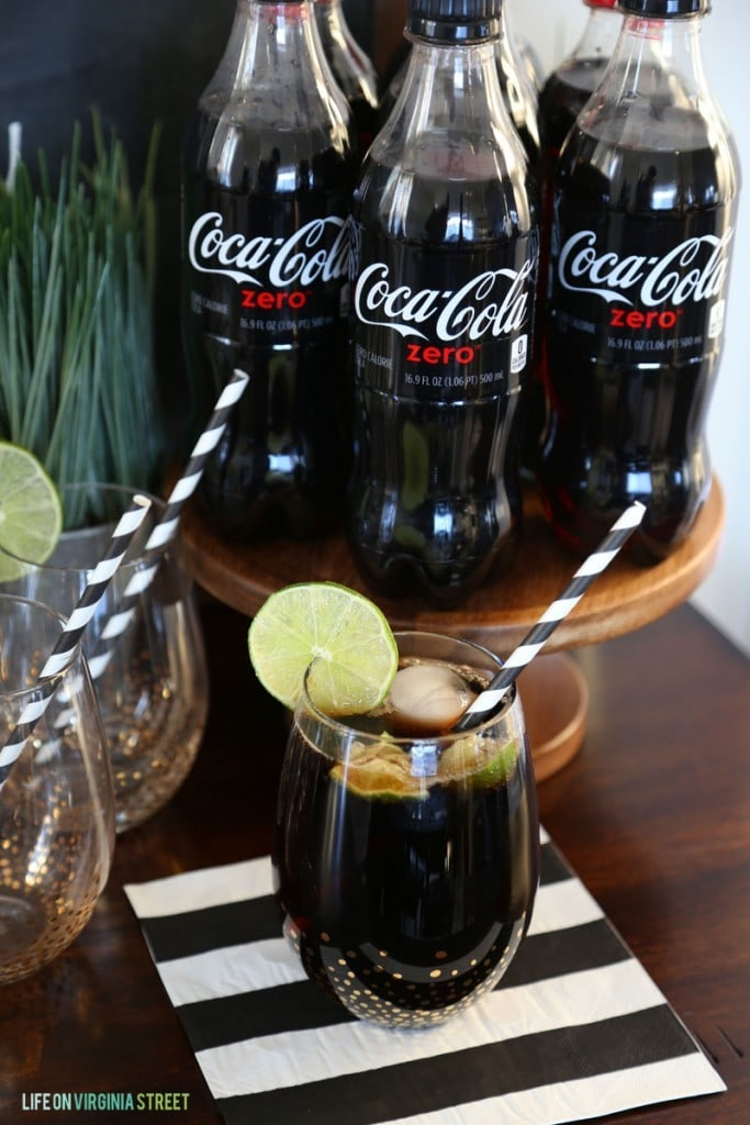 Coke Zero with Lime in a glass on the table.