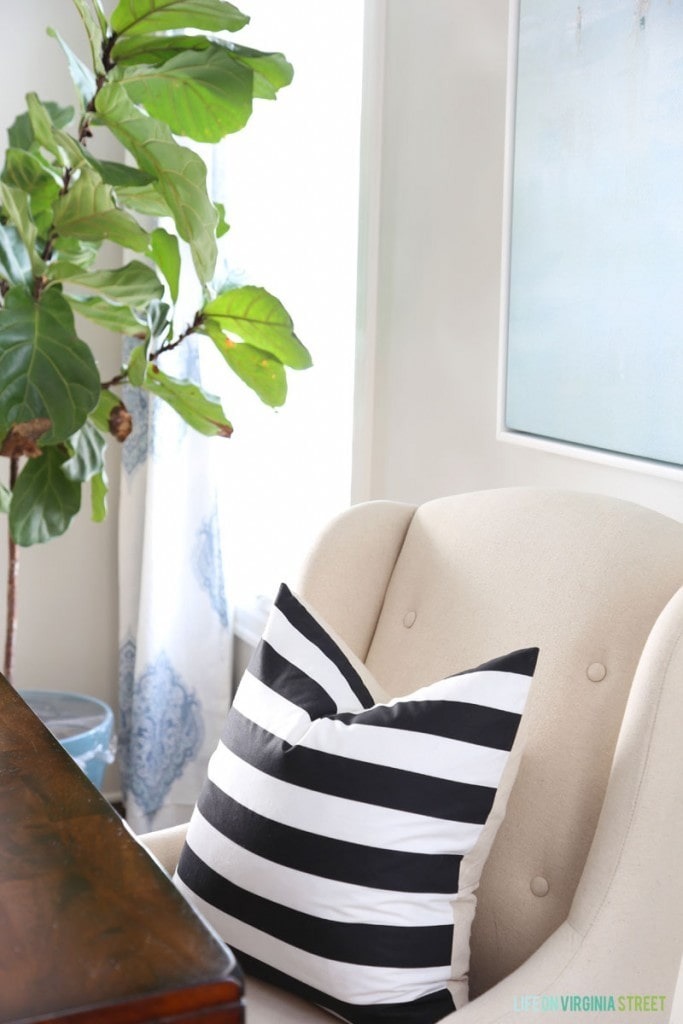 DIY Black and White Striped Pillows on the chairs in the dining room.