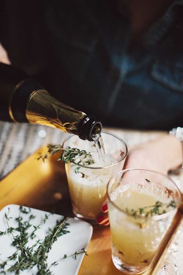Pear Nectar Thyme Mimosas via The Glitter Guide