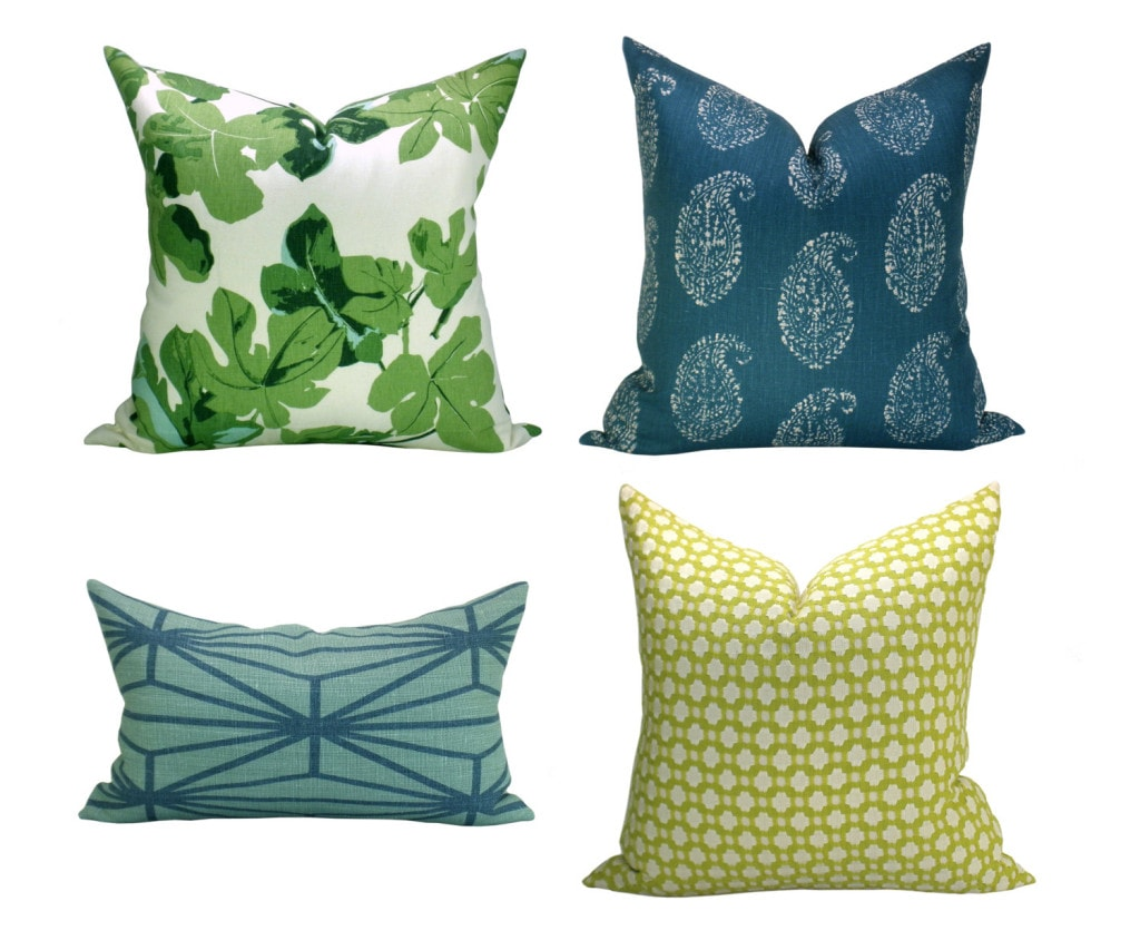 Pillows with fig leaves on them.