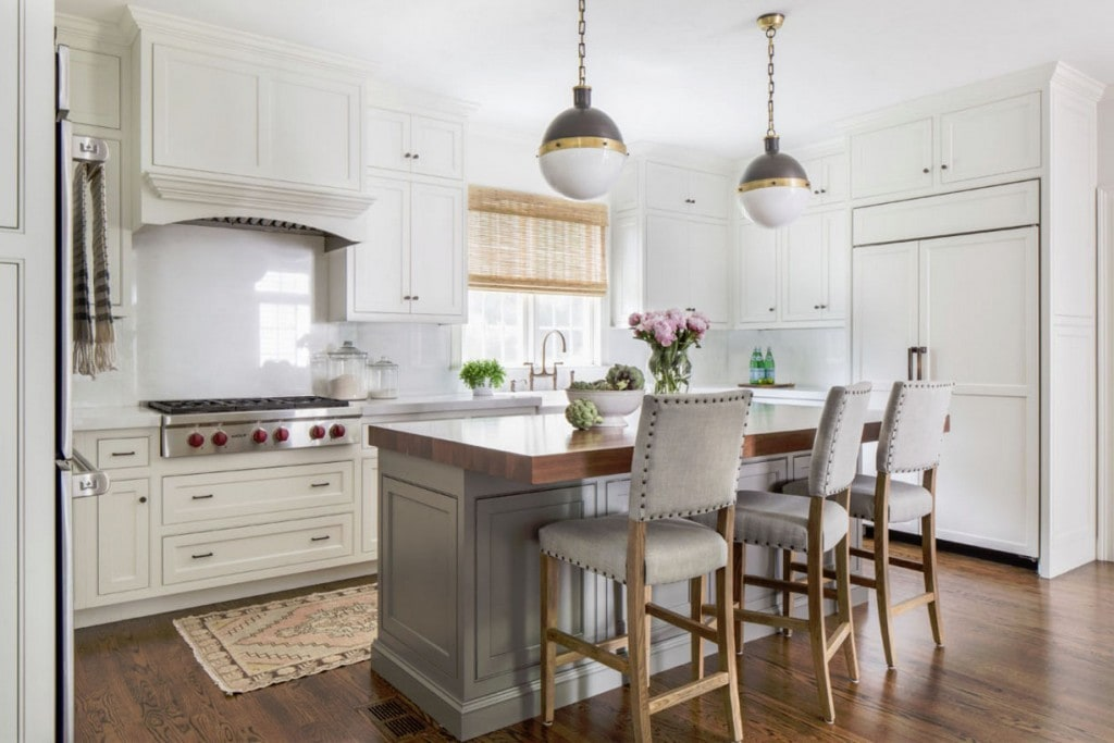 Kitchen with White Cabinets, Gray Island, Blush Pink Runner Rug, Bamboo Roman Shades, David Hicks Pendant Lights and Farmhouse Sink
