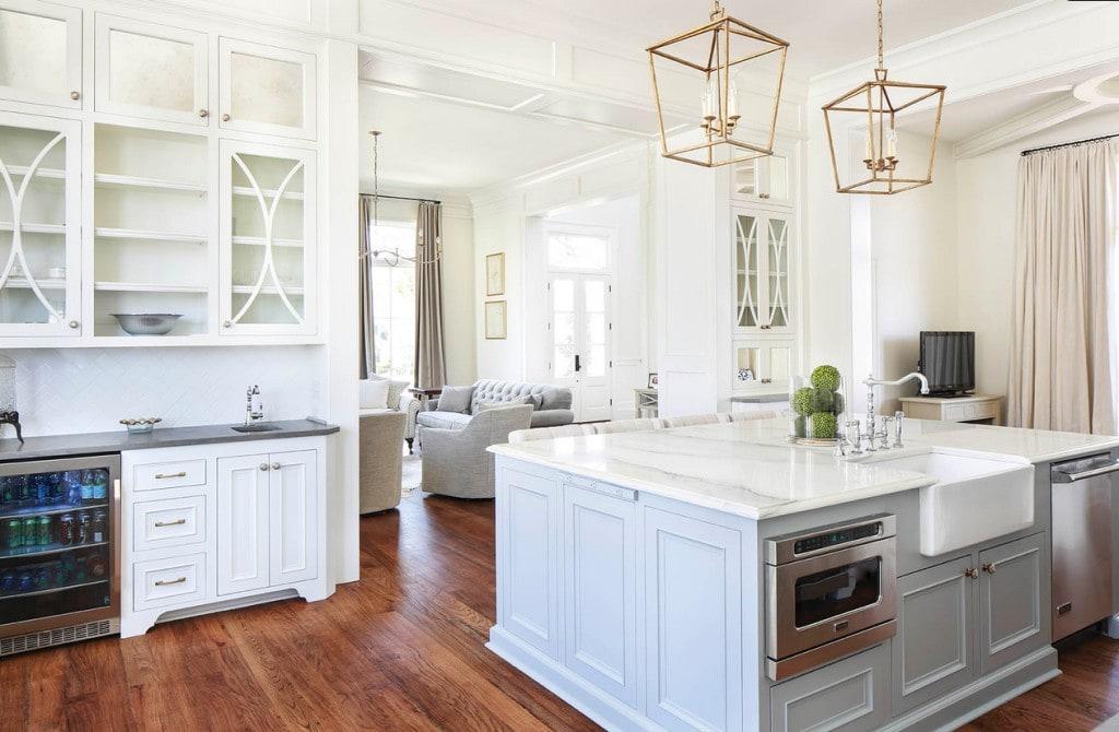 White Kitchen with Gold Darlana Pendants Over Island via Telich Custom Homes