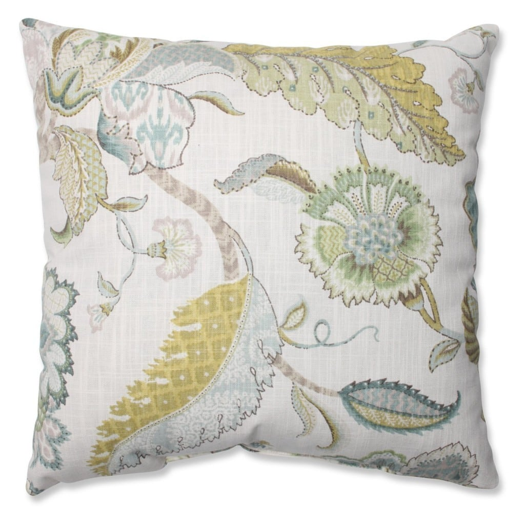 A floral pillow with soft green, yellow and blues.