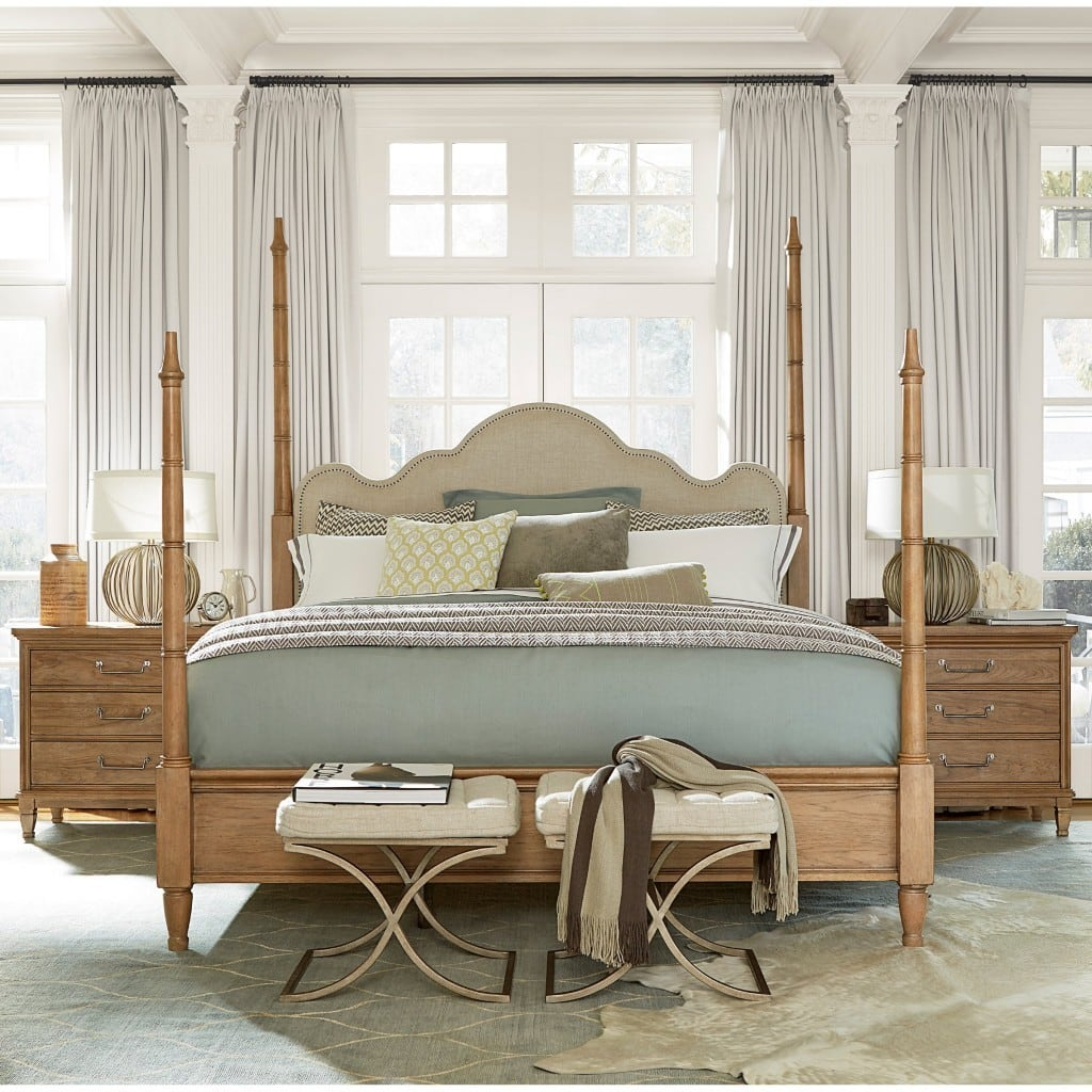Universal Furniture Moderne Muse Maison Poster Bed with light coloured wood and soft grey bedding.
