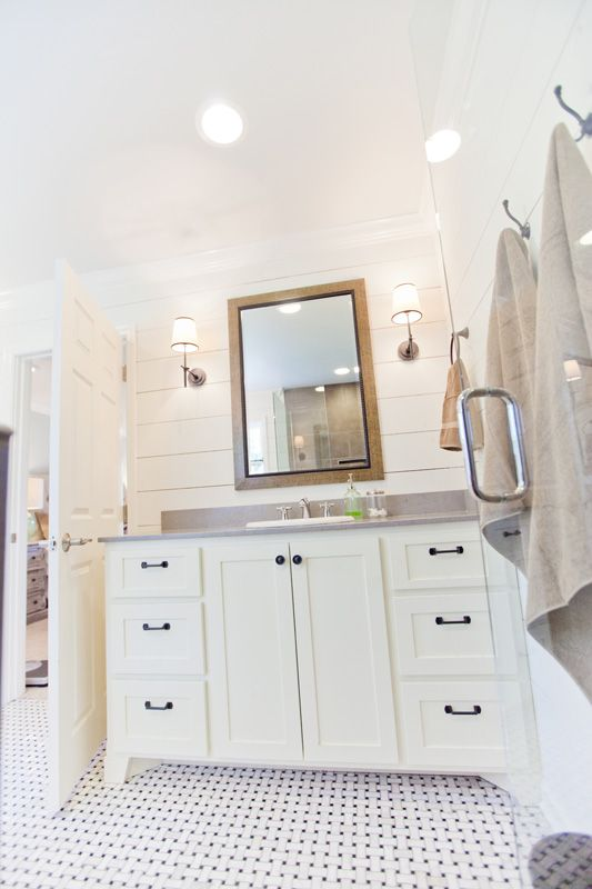 White Bathroom with Shiplap Walls and Tile Floor source unknown via