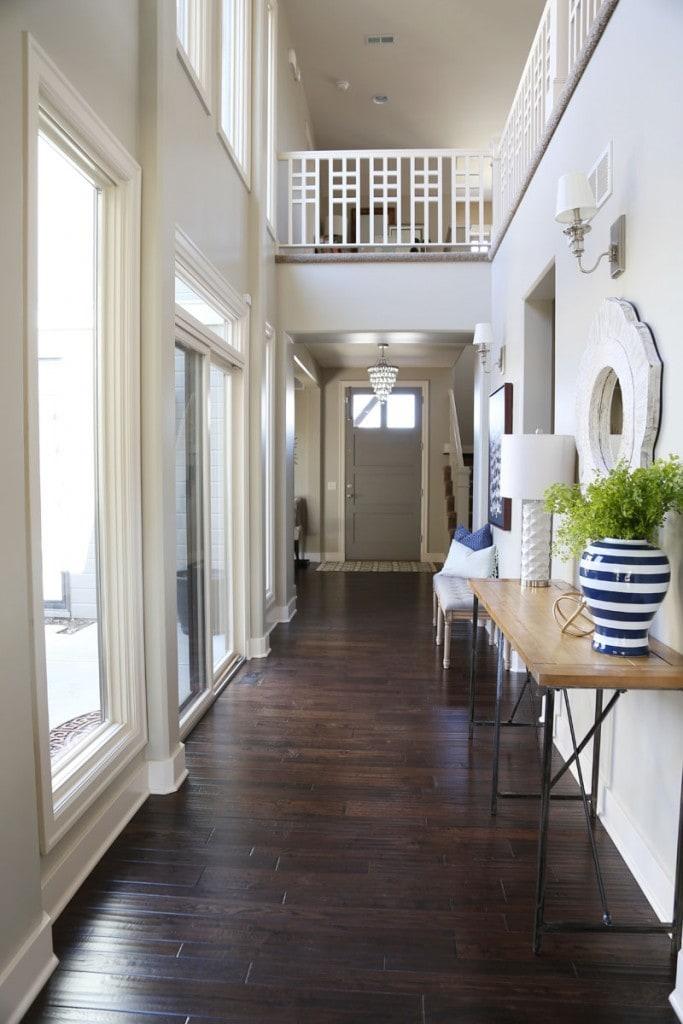 Dark wooden floor in entryway with small hallway lights.