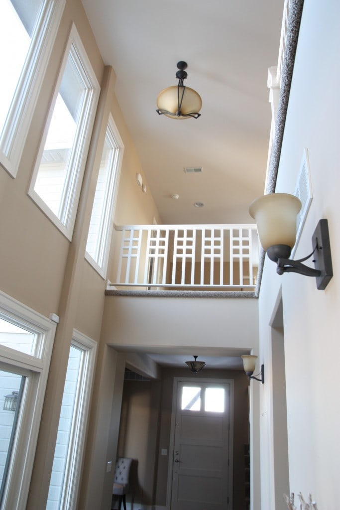 A neutral painted hallway with wall lights in brushed dark metal.