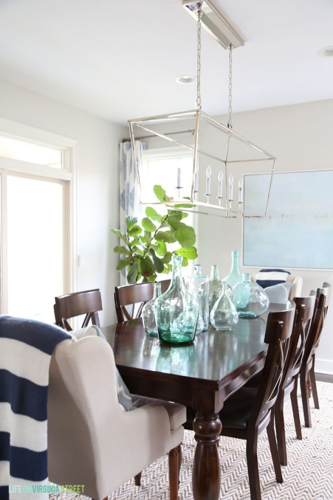 Spring Dining Room with Navy Stripes and Glass Bottles via Life On Virginia Street