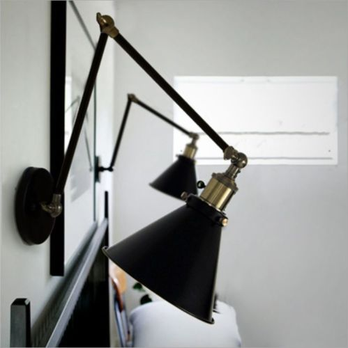 Industrial Swing Arm Sconce from eBay in black with brass details.
