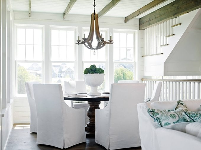 White Dining Room in a Florida New-England Style Home via House of Turquoise