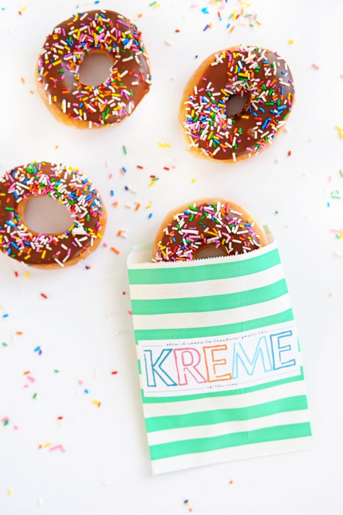 A donut printable with chocolate icing and multi coloured sprinkles on the donuts.