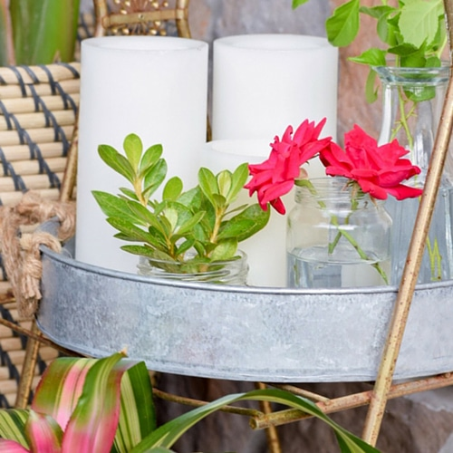 Plants and flowers in a galvanized outdoor tray.
