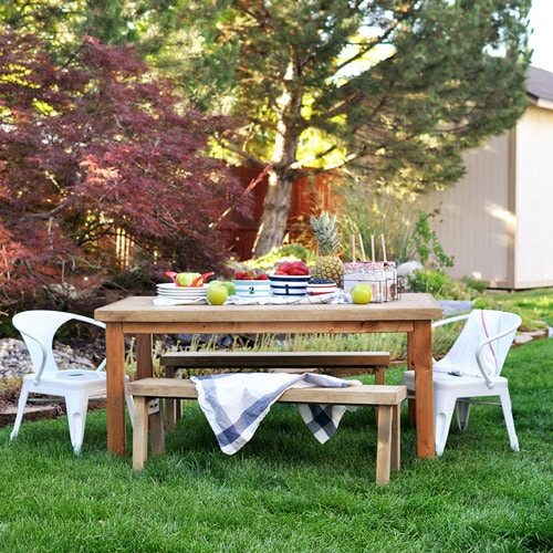 An outdoor picnic table set for eating.