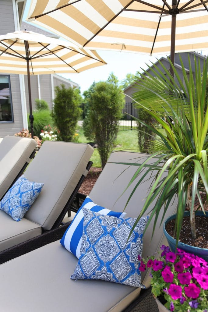 Serta Outdoor Collection Wicker Patio Chaise Lounge with Cushions in a Colorful Backyard via Life On Virginia Street