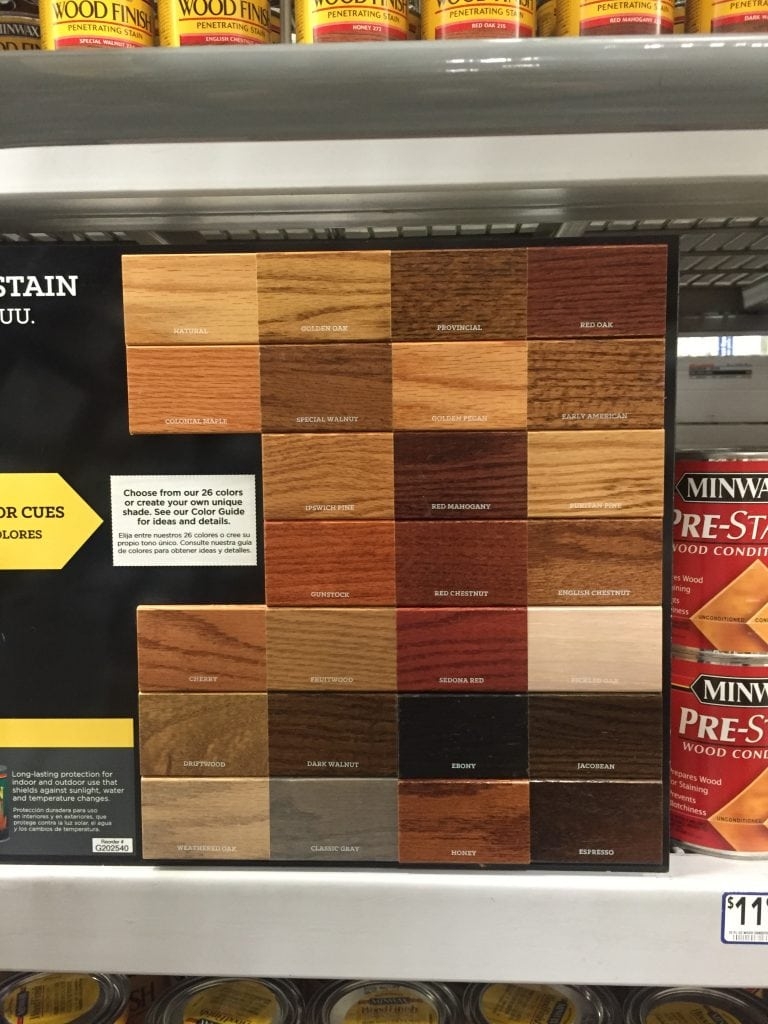 Minwax Stain examples in the store, trying to pick.