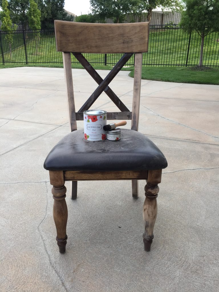 Sanded wood chair with stain can on the seat of the chair.