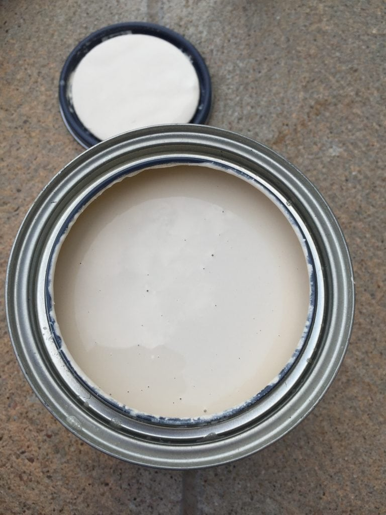 Country Chic Paint in Cheesecake with the lid off looking inside at the color.