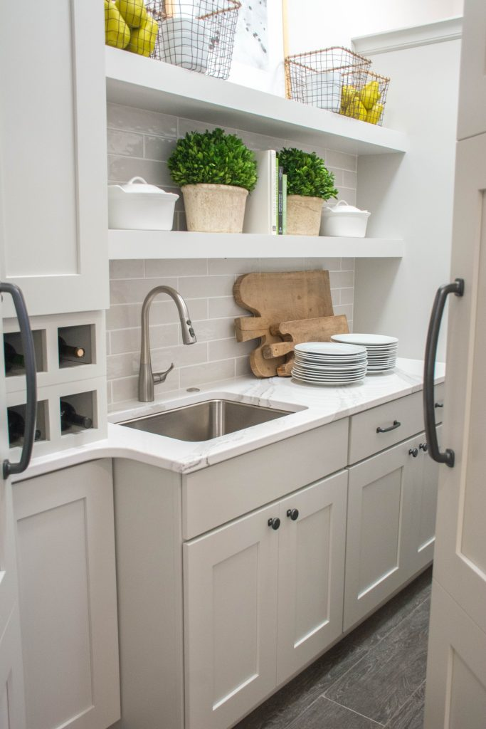 Walk-in Pantry with White and Gray Cabinets and Sink. Image via Mandy McGregor Photography.