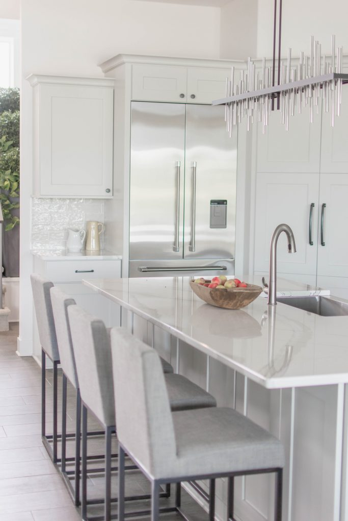 White and gray kitchen via Omaha Street of Dreams. Image via Mandy McGregor Photography.