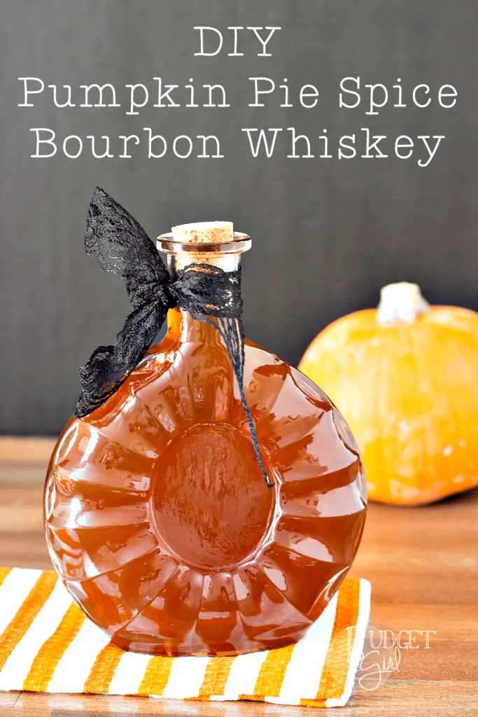 Pumpkin pie spice bourbon whiskey in a whiskey bottle with a black bow around it.