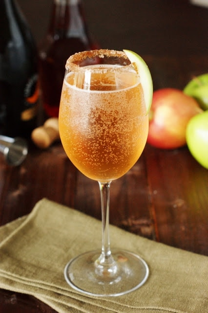 Sparkling apple cider in wine glass.