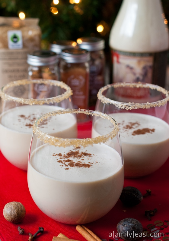 Eggnog in a clear glass with spiced rim.