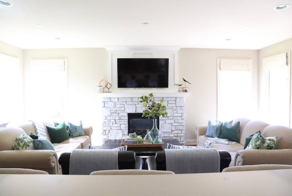 neutral-living-room-with-blue-and-green-accents-and-fig-leaf-pillows