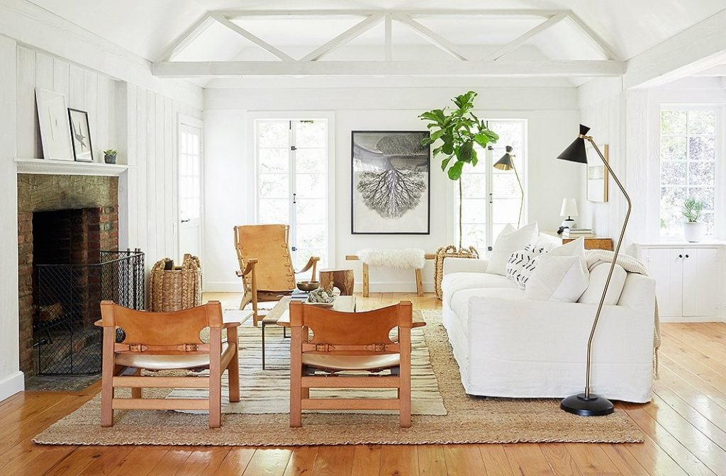 White home tour with leather and wood accents via Jenni Kayne