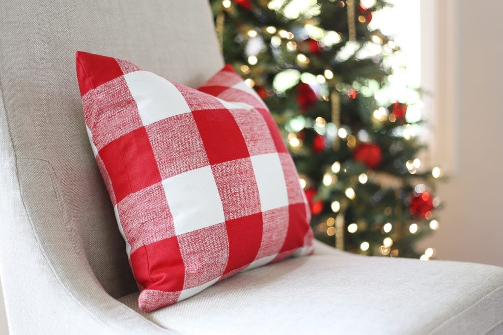red-and-buffalo-check-pillow-in-a-christmas-dining-room-via-life-on-virginia-street