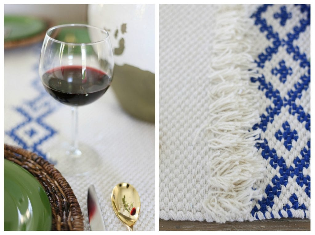 Up close picture of the red wine and blue and white table runner.