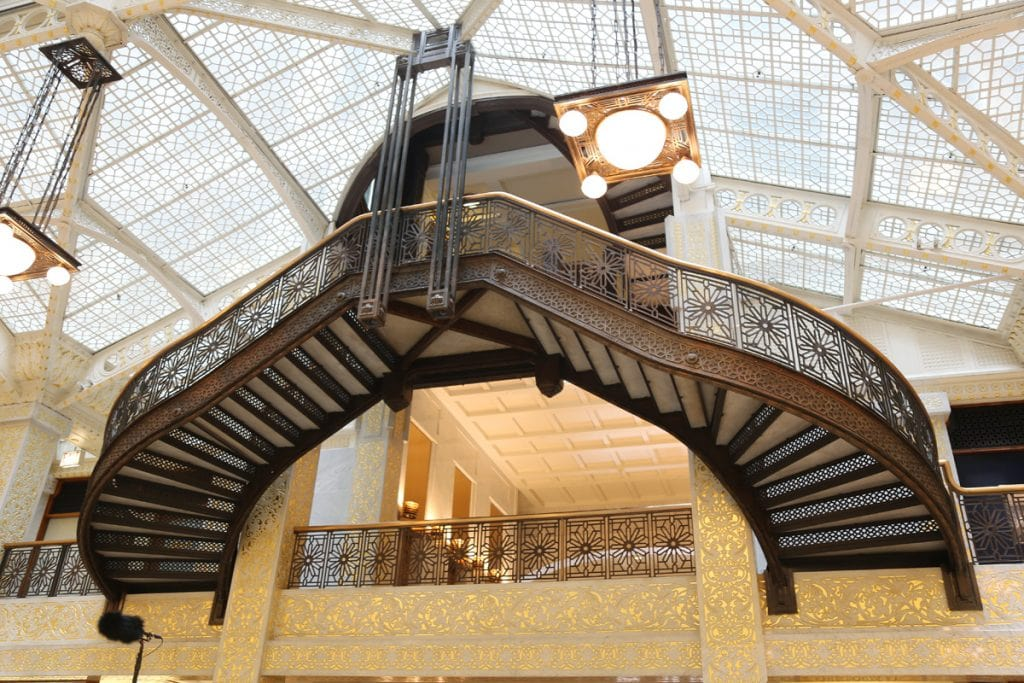 The ornate suspended staircase, with a glass ceiling.