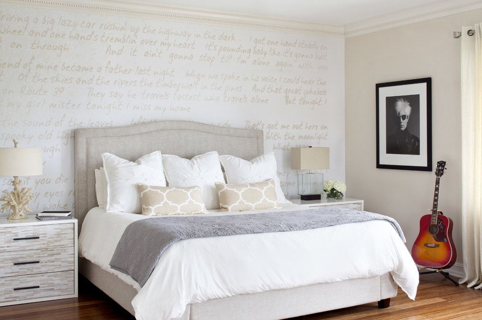 Neutral bedroom with song lyrics on wall