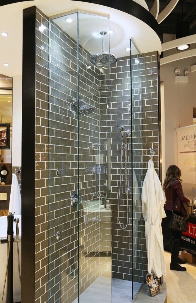 A shower stall in the showroom with the faucet ideas.