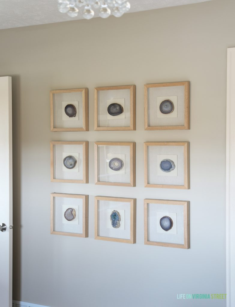 Agate framed gallery wall in a guest bedroom.